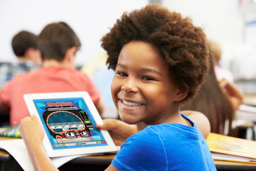 Elementary student using a tablet to develop social-emotional skills in the classroom.
