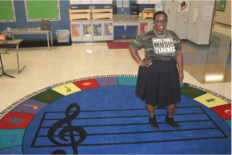 Image of Quaver teacher Alicia Engram standing in her music classroom