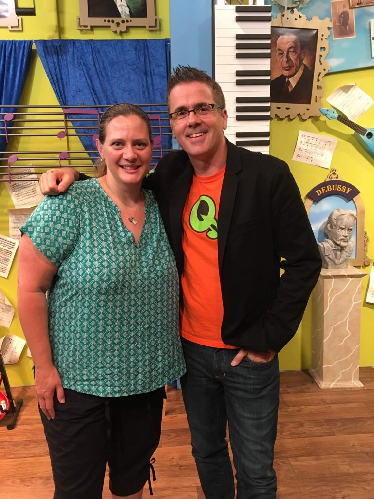 A smiling Barbara Hartman poses with Quaver's Graham Hepburn during a visit to the company's Nashville headquarters.