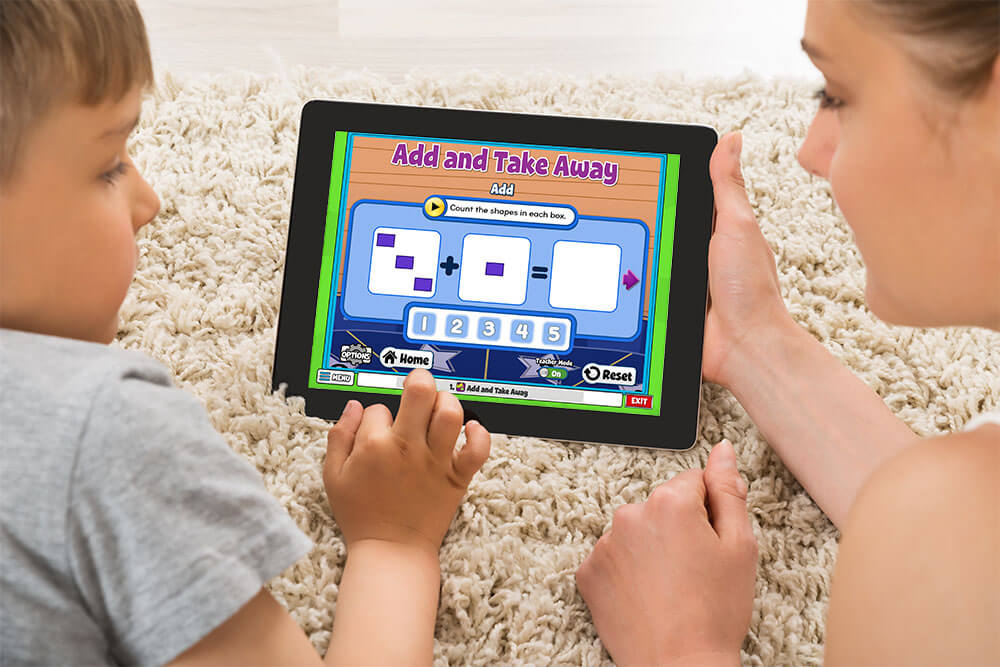 Teacher or parent and student do a math activity on an ipad together